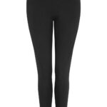 Woman with black zipped top and cotton pant, pilates clothing for women